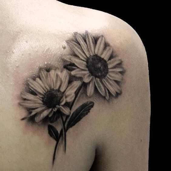 A foto da tatuagem de margaridas blade menina