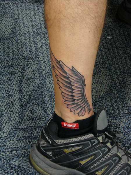 A tatuagem do cara-t - asas
