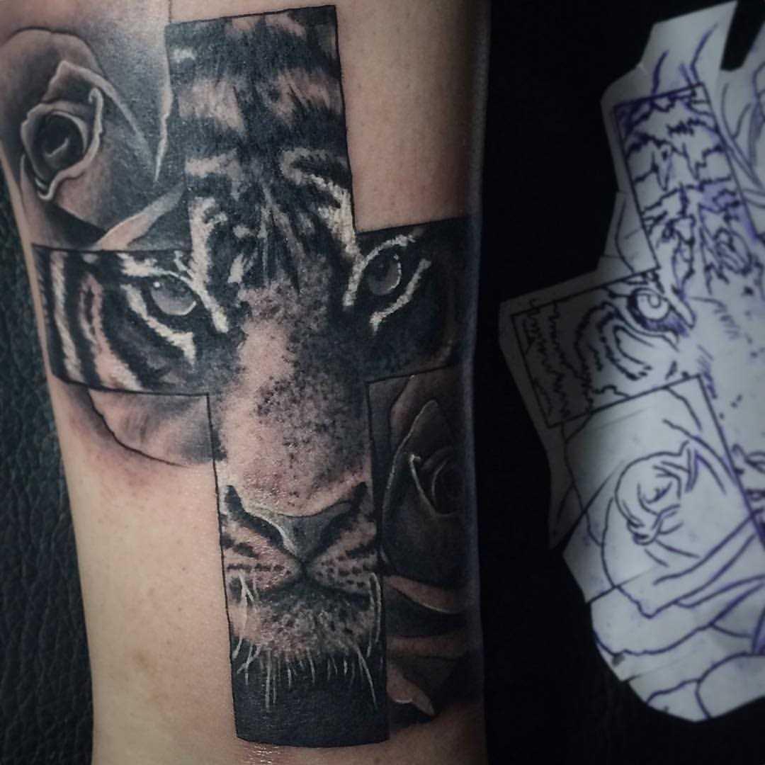 A tatuagem no ombro de um cara - a cruz e a rosa
