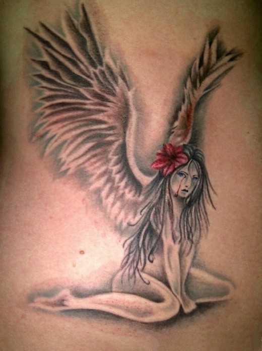 Bela tatuagem que tem no cóccix menina - anjo