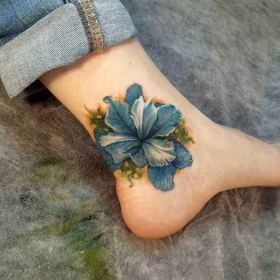 Fotos de tatuagem azul iris-t menina
