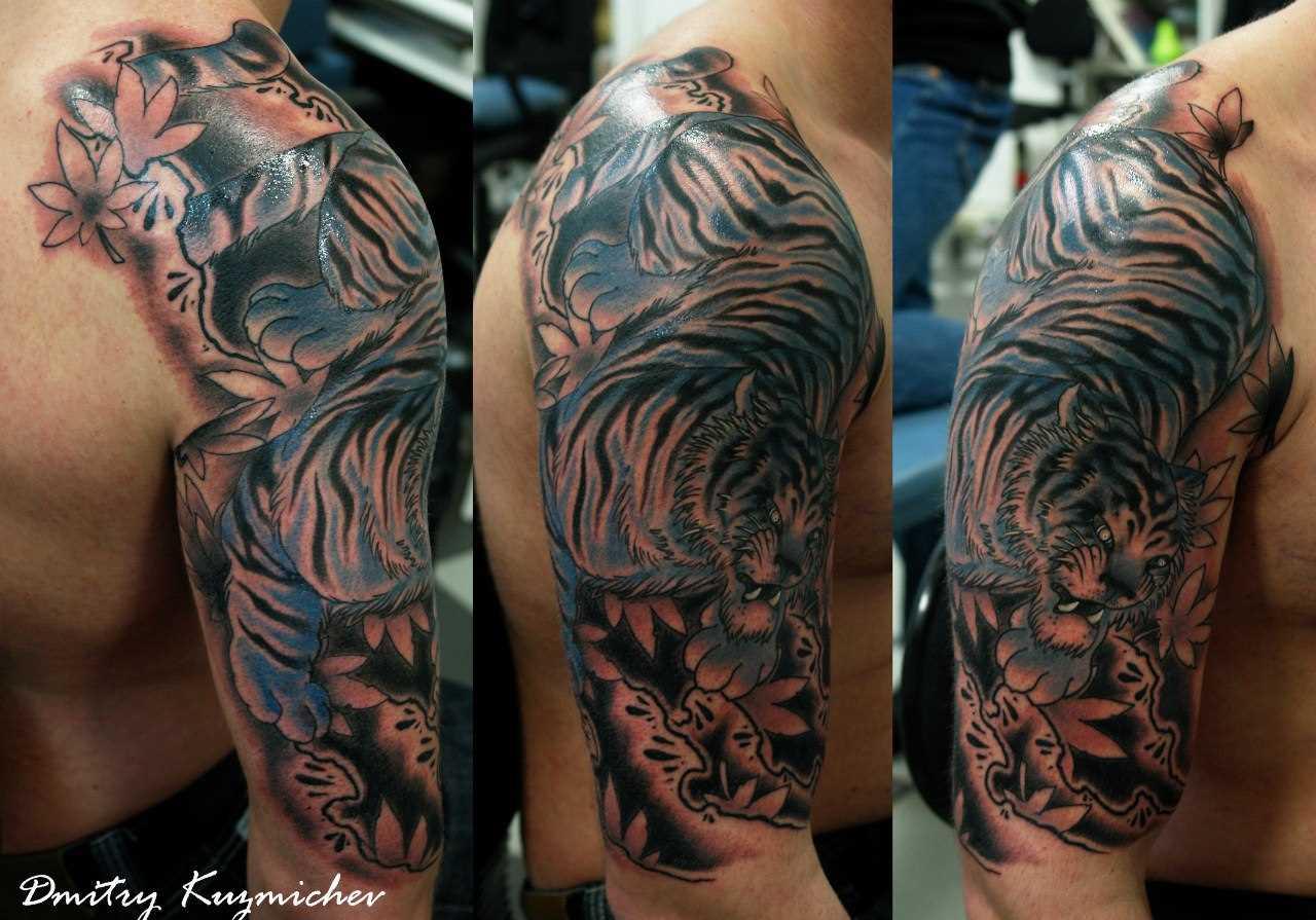 O tigre - de tatuagem no ombro do cara