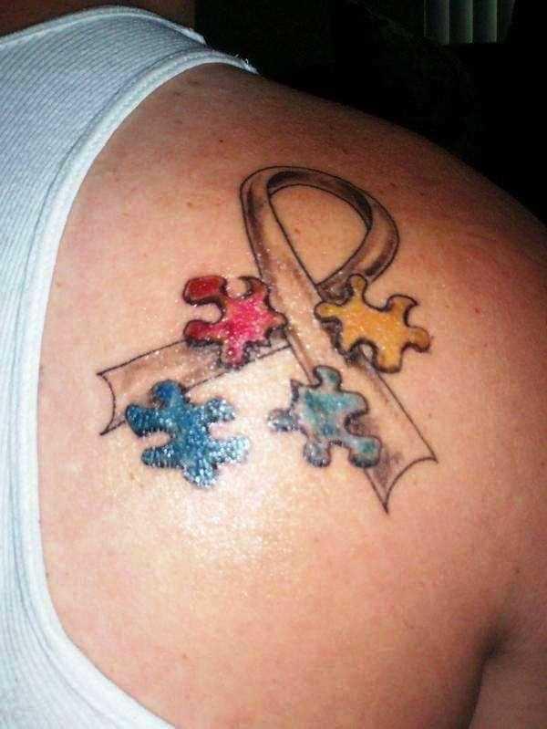 Tatuagem blade cara de quebra - cabeças e fita