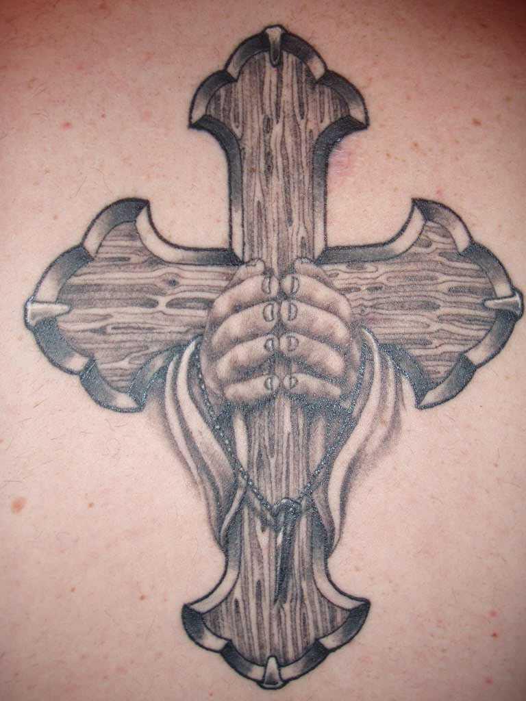 Tatuagem na coluna da menina - cruz na palma da mão