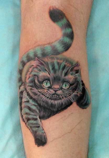 Tatuagem na perna de um cara - de- gato de cheshire