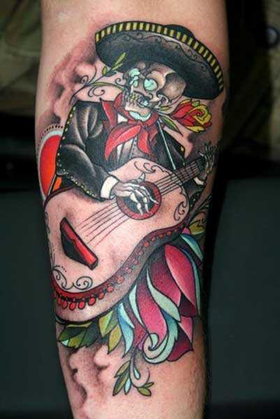 Tatuagem no antebraço meninas - guitarra e o esqueleto