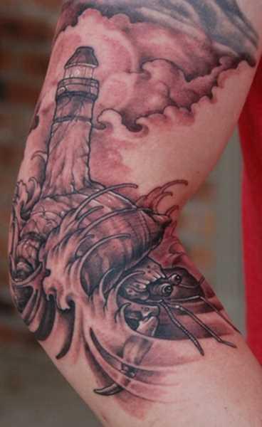 Tatuagem no cotovelo do cara - farol