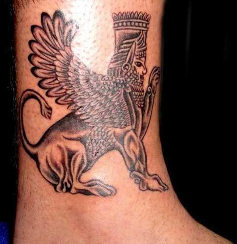 Tatuagem no tornozelo preto cara - a esfinge
