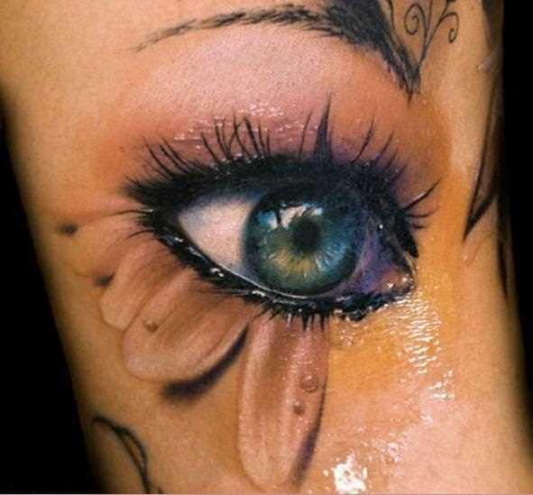 Tatuagem que tem no braço a menina dos olhos