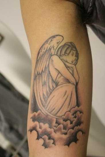 Tatuagem que tem no braço do cara - de- anjo no céu