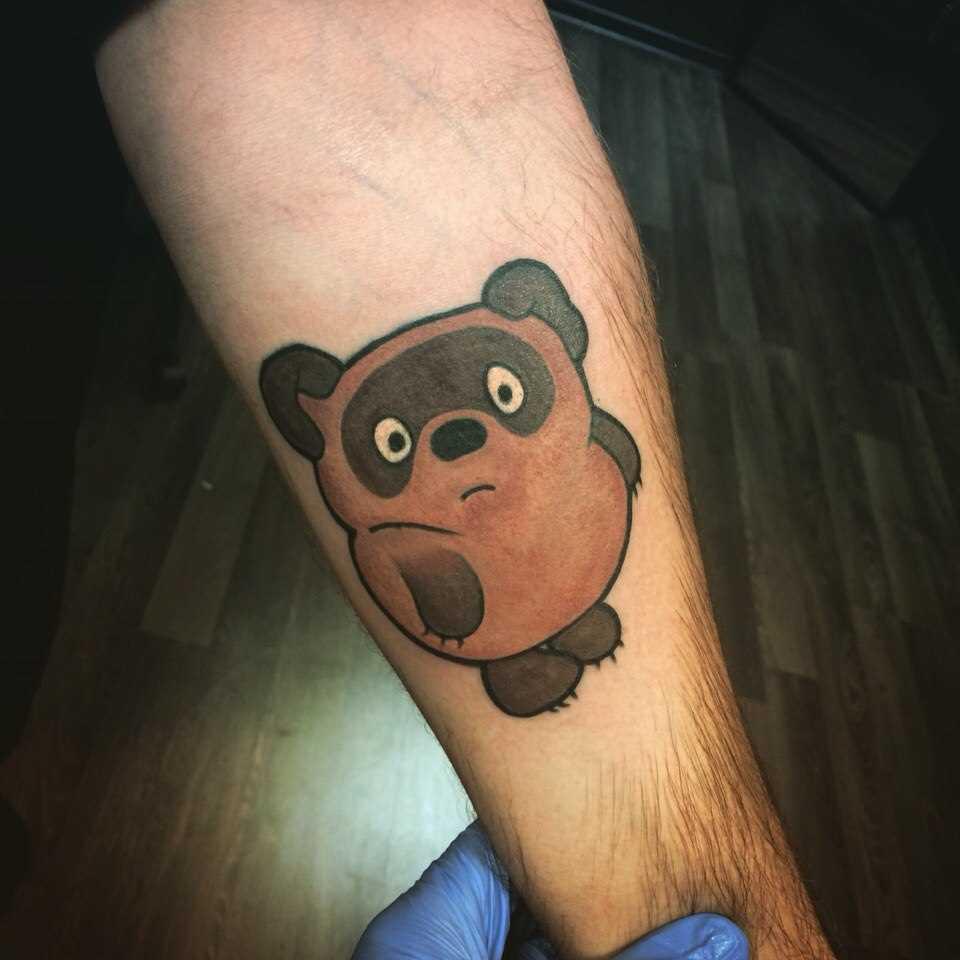 Winnie the Pooh - tatuagem no antebraço cara